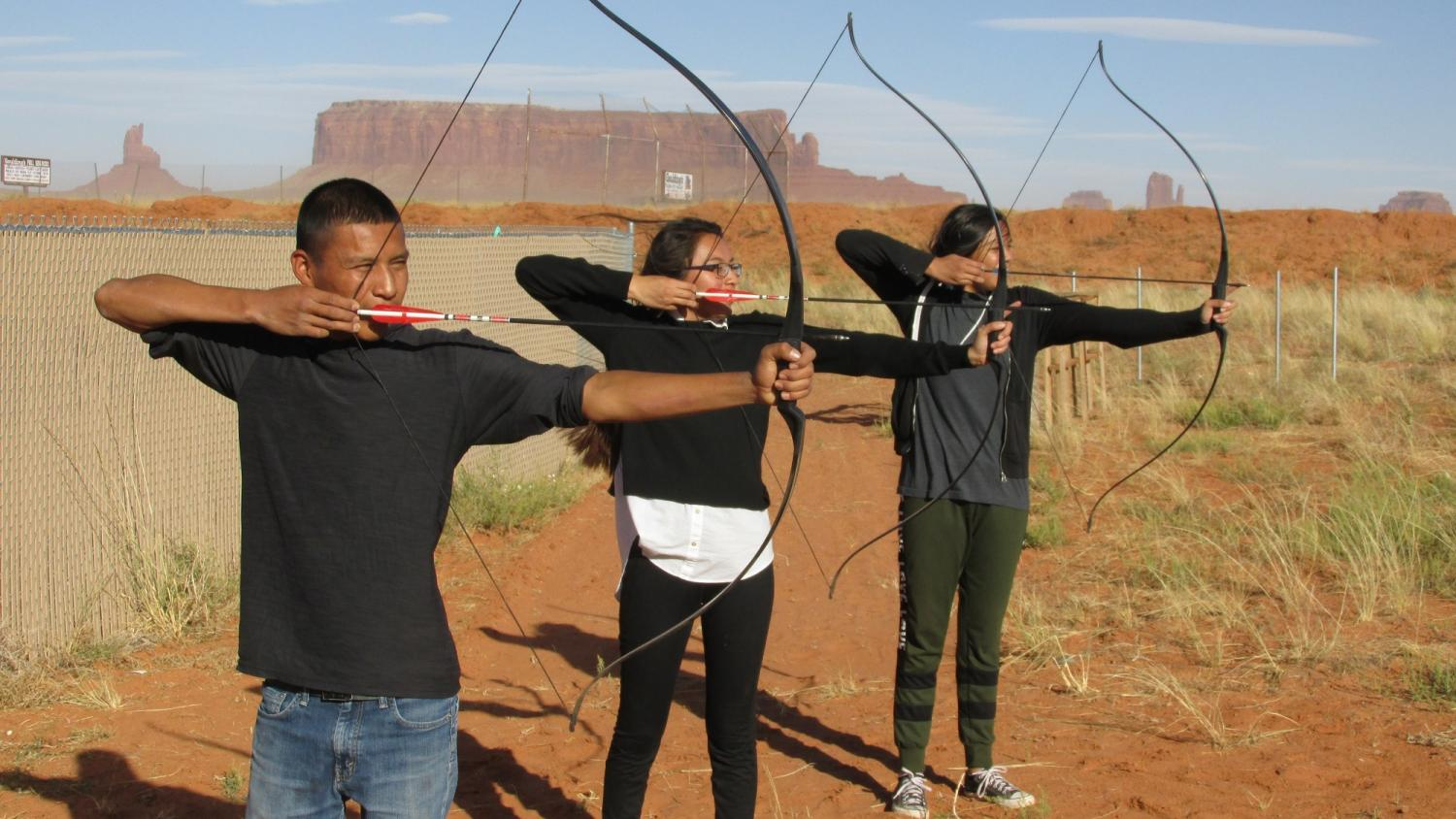 Members of the MVHS Archery Club test their skills at a recent club meeting. The club members are, from left to right, Michael John, Kimberlyn Yellowhair and Karrilyn Yellowhair, (Photo by Tiffany Durham).