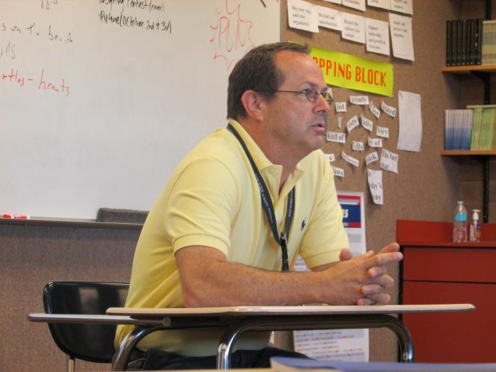 Assistant Principal Michael Tuckfield listens to a question during a journalism class interview. (Photo by Maya Atene)